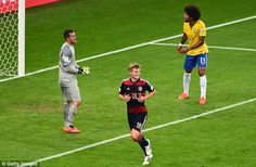 Kroos-ing to victory: Kroos wheels away to celebrate after scoring his second goal two min...