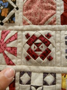 "close up, Mini Dear Jane by Barbara Larson: 2"" blocks.  Photo by Floating on a Quilted Cloud: Vermont Quilt Festival"