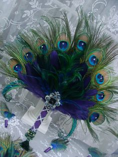 Feathered Elegance Peacock Feather Fans in Multi Peacock Colors in your choice of sizes Peacock Wreath, Peacock Decor, Peacock Colors, Peacock Theme, Peacock Feathers, Peacock Wedding, Butterfly Dragon, Monarch Butterfly, Coloured Feathers