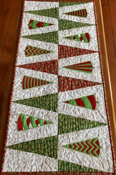 Online center for machine embroidery designs. On this site you can find machine embroidery designs in the most popular formats, with a new free machine embroidery design each month. Free embroidery projects, tips and tutorials are also available. Christmas Runner, Small Christmas Trees, Simple Christmas, Christmas Patchwork, Christmas Sewing, Christmas Crafts, Christmas Quilting, Xmas Table Runners, Quilted Table Runners