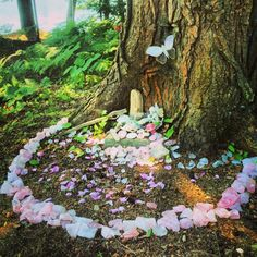 newmoongoddess:  My Dearest friend has the most amazing faery garden! Looks like the gates of Avalon! Surrounded by chunks of rose quarts, quartz crystals, gifts and candy! Be still my heart~
