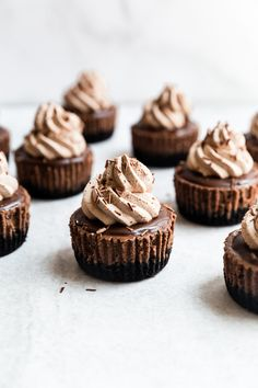 Rich and decadent mini triple chocolate cheesecakes are layered with three kinds of chocolate for the ultimate chocolate lover's indulgence. Short on baking time and big on wow factor, these mini cheesecakes are a real crowd pleaser. Individual Cheesecakes, Mini Cheesecakes, Mini Desserts, Easy Desserts, Dessert Recipes, Chocolate Whipped Cream, Chocolate Ganache, Chocolate Treats, Chocolate Lovers