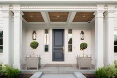 Gray Front Door - Design photos, ideas and inspiration. Amazing gallery of interior design and decorating ideas of Gray Front Door in home exteriors, decks/patios, entrances/foyers, porches by elite interior designers. Design Exterior, Exterior Paint, Interior And Exterior, Interior Door, Cafe Exterior, Colonial Exterior, Bungalow Exterior, Cottage Exterior, Exterior Siding