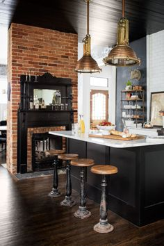 Fireplace & Swivel Stools:  Early American kitchens had fireplaces for cooking. Electric ovens have now taken their place, but we'd kill for this quaint, historic detail in our modern homes. In the forefront, sweet little stools are reminiscent of an old fashioned soda shoppe.