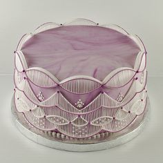 Flawless pink stringwork cake from CakeCentral.com by Gefion