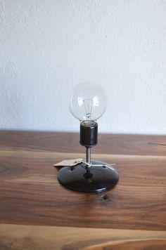 Black Industrial modern minimalist wall sconce light.  Globe light bulb. Bathroom, bedroom, hallway lighting.