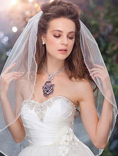 Alfred Angelo Bridal Style 122 from Disney Veils not sure if I would want a veil but it's so simple and elegant!