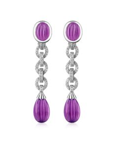Absolutely outstanding and supremely luxurious, drop earrings are made with carved gemstones and enriched by a total of 0.60 carats of dazzling diamonds for sophisticated sparkle. Gift box included, Made in Italy