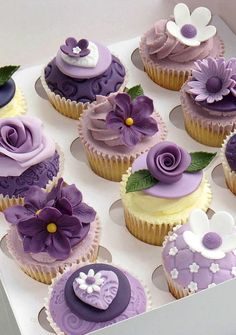 Impress your loved ones with our Lovely Luxury Cupcakes. The cupcakes are topped with tasty frosting swirls and fondant art they are sure to love! Cupcakes Flores, Purple Cupcakes, Fondant Cupcakes, Cupcake Cookies, Lavender Cupcakes, Flower Cupcakes, Cupcake Toppers, Yummy Cupcakes, Spring Cupcakes
