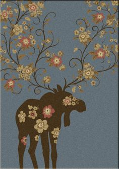 An American Dakota rug, Moose Blossom, is a unique blend of rustic and contemporary and comes in blue, brown and natural background.  See it at cclranchdecor.com.