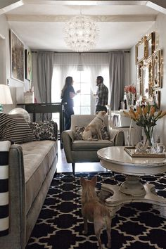glam details - chandelier, frames, coffee table, neutral colors with black & white and gold