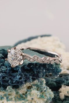 Delicate details give this engagement ring show-stopping beauty.