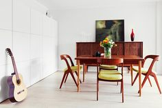 dining room with yellow - green upholstery on chairs