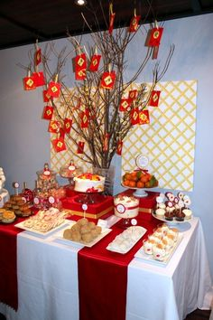 A perfect Chinese New Year buffet: moon cakes, lychee candy, haw flakes, sesame balls, and tree of wishes Chinese New Year Party, Chinese New Year Decorations, Chinese New Year Crafts, New Years Decorations, New Years Party, Chinese New Years, Chinese Theme Parties, Asian Party Themes, Party Ideas