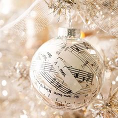 Use paper scraps or old sheet music to decorate a glass ornament.