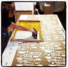 Screenprinting some gift wrap for a few last minute orders! by Dolan Geiman, via Flickr  { looks fun; paper, fabric }