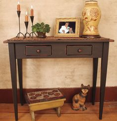 Sofa Table. Like the two drawers (his and hers) with space to put shoes and/or other storage underneath. For Foyer.