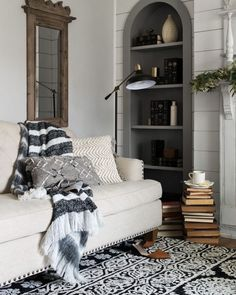 You have to see this #farmhouse living room decor idea with an inside window overlooking the kitchen and black and white furniture palette . Love it! #RusticDecor #HomeDecorIdeas
