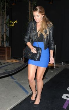 blue skirt, black shirt, black purse and black suede pumps