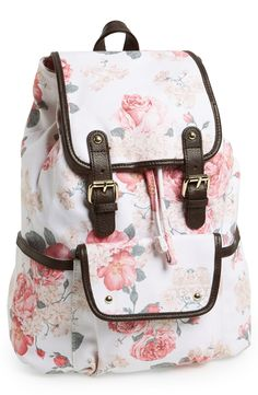 Such a pretty pink floral print on this leather trim backpack.