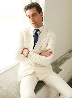 Light to White: A Study in Contrasts    Wearing a white suit and wearing one well are two different propositions, and the key to doing the latter isn't in the uniform consistency of the whites involved but rather in the contrasts. A cream-colored suit pairs best with a bright white shirt — the subtle difference in the two shades distinguishes one from the other