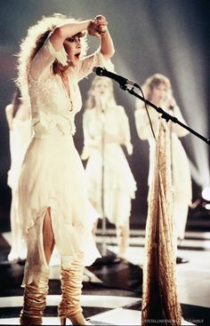 Stevie ~ ☆♥❤♥☆ ~ and the girls, wearing pale, pale cream Margi Kent outfits, performing 'If Anyone Falls', 1983 ~ love how Stevie's tied her glittery shawl to her microphone stand ~ this is the second single from her second solo album, 'The Wild Heart' ~ https://youtu.be/U8YXBKS6dok