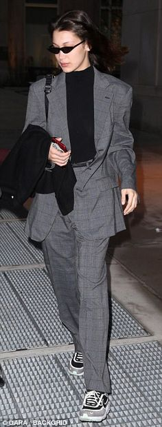 28ada92b821d6 Bella Hadid steps out in gray plaid blazer and trousers with sneakers