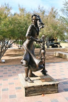 Girl at Well Sculpture in Frisco, Texas.  Photo by: Joe Adams III   You Be the Tour Guide Entry - 2012