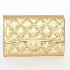 CHANEL Classic flap wallet Gold Timeless New Without Tags and Papers. This item was a store dusplay and it's missing card authenticity and dustbag. Still in excellent condition, flawless.  Soft Quilted Leather, Chic Gold Tone and tons of credit card insert plus a zipped pocket. Shop with confidence as this item will be authenticated with the Poshmark Service. CHANEL Bags Wallets