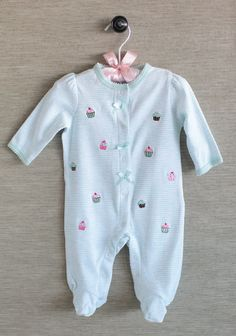 This soft cotton footie is as sweet as can be with mint and ivory stripes, adorable embroidered cupcakes, and scalloped details. Perfected with dainty satin bows tied just so and front snap closures. Machine washable.100% Cotton, Imported      This is adorable! lol