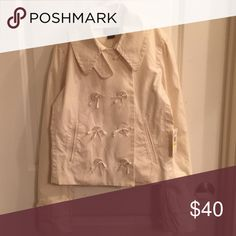 NWT Polo by Ralph Lauren jacket It has eight buttons with bows and anchor prints. The collar can be fastened tighter with one of the buttons for extra protection against the cold weather. It's shown in the first picture. It comes with extra buttons. The last picture is the back. It's beautiful fashionable jacket. The price is firm. Bundle & get $3 off. Can't be combined with other offers. Polo by Ralph Lauren Jackets & Coats Pea Coats