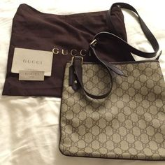 Authentic Gucci crossbody bag brown Beautiful and authentic Gucci handbag with authenticity cards and dust bag. Mint condition. Perfect size for anything from going out to work. Please ask questions, and accepting offers. Gucci Bags Crossbody Bags