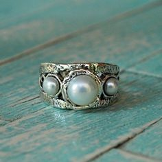 This isn't your grandmother's pearl ring! Three white freshwater pearls rock a sterling band with swirl detail.