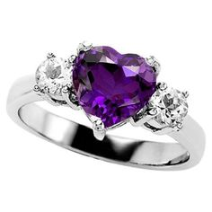 Heart engagement ring with purple amethyst.