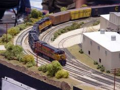 UNION PACIFIC PULLING A PASSENGERS SERVICE & FREIGHT BUSINESS IN TRAIN JOURNEY TO TOWN WITH ROLLING STICK