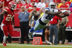 Dez Bryant #88 of the Dallas Cowboys makes a leaping downfield catch within the ten yard line.