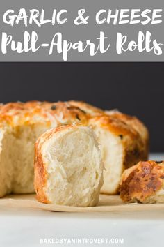These Cheesy Pull-Apart Rolls are loaded with garlic, sharp cheddar, and parmesan cheese. The ultimate cheesy roll to serve alongside soup and salad. #bakedbyanintrovertrecipes #rolls #cheesebread #yeastbread #garlicbread #garlicrolls #cheeserolls  via @introvertbaker