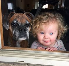 This Photo of a Dog and Baby Watching the First Snow Is Priceless