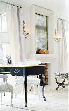 Don't have space for a home office? Carve out a small space in the living room-- and while your at it make it a bold statement like this black desk and white chairs. Patio Interior, Home Interior, French Interior, Modern Interior, Home Office, Office Workspace, Log Home Designs, Black And White Interior, Black White