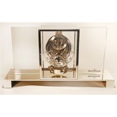 Jaeger LeCoultre Atmos Regulateur Transparente glass table id=description clock. #1 of 50. Complete with Certificate of Origin and current official Jaeger LeCoultre insurance appraisal. Powered by minor changes in temperature and atmospheric air pressure.