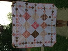 Baby girl quilt - i like the pink and browns not sure about this design though