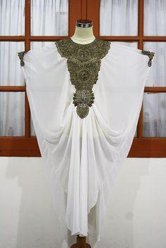 Gorgeous Super white moroccan kaftan Dubai style gold embroidery abaya maxi dress hijab jalabiya. $65.00, via Etsy.