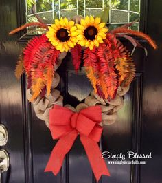 This wreath combines 2 of this years favorite trends....burlap and owls! The wreath is the perfect size for your front door or to use as an