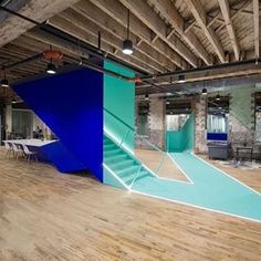 New York-based Leeser Architecture has inserted angular and brightly coloured stairwells into an ageing industrial building in Brooklyn to create a vibrant office for creative professionals and entrepreneurs. Discover more repurposed buildings on dezeen.com/tag/adaptive-reuse #architecture #office #Brooklyn #NewYork #industrial