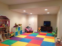 finished basement kids. Finished basement playroom project  Foam puzzle flooring from One Step Ahead Each colored square OMG I think just found what want to do for a workout area