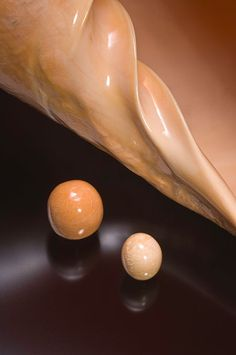 Melo pearls with Melo melo shell. Visible is the whorl of the shell from which the pearl simulant shown in this image may have been carved. ...
