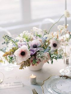 Elegant wedding centerpiece idea- anemone centerpiece and greenery - Find a wedding planner in your city on WeddingWire! {Leigh and Mitchell}