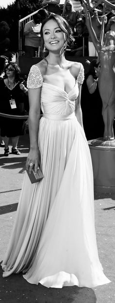 Olivia Wilde in a stunning dress... This is truly an amazing dress. Feminine.