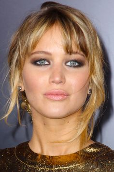 Katniss Kills in this sultry yet sweet Fall look-notice the dark brows and heavy liner that's paired with a playful neutral pout