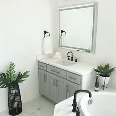 My master bathroom is finally coming together now! Tile, mirrors, lighting, plumbing fixtures, drawer pulls and accessories all had to be changed or added from the new construction. Just missing some art on the walls and a few more accessories! Modern Bathroom, Master Bathroom, Manufactured Home Remodel, Plumbing Fixtures, Drawer Pulls, My Dream Home, Home Remodeling, Drawers, Interior Decorating